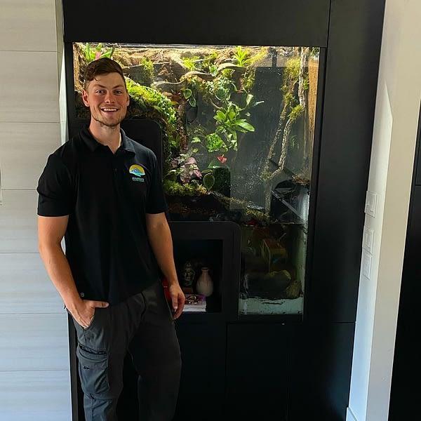Ben In Front Of Recently Installed Terrarium
