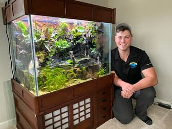 Owner In Front Of Recently Cleaned Vivarium