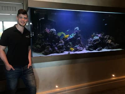 Owner In Front Of Cleaned Fish Tank